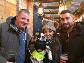 Paul Armstrong from The Ship, Holy Island, Sophie Bancroft and Andy Cowan with Dexter the dog